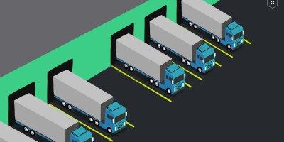 Semi trucks parked in loading docks of a warehouse